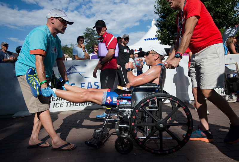 "Todd Miller is escorted away from the finish line in a wheel chair after completing the 2016 Ironman Boulder on Sunday. <br /> More photos:  <a href=""http://www.dailycamera.com"">http://www.dailycamera.com</a><br /> (Autumn Parry/Staff Photographer)<br /> August 7, 2016"