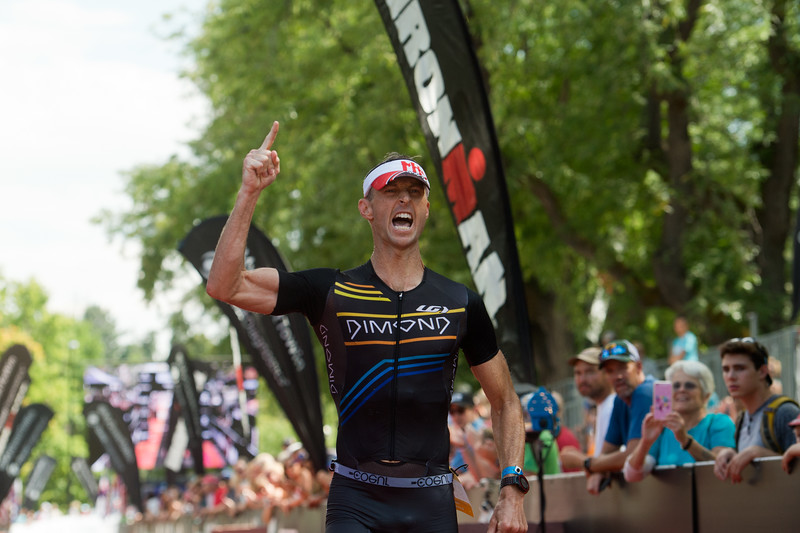 "A participant cheers as he crosses the finish line of the 2016 Ironman Boulder on Sunday. <br /> More photos:  <a href=""http://www.dailycamera.com"">http://www.dailycamera.com</a><br /> (Autumn Parry/Staff Photographer)<br /> August 7, 2016"