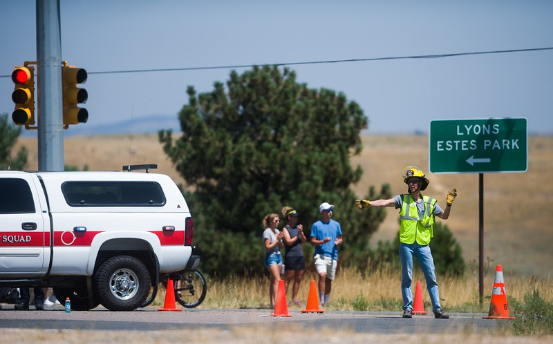 "A member of the Boulder Rescue Squad redirects traffic at the intersection of Broadway and U.S. 36 after 34-year-old Michelle Walters of McCook, Neb. was struck and killed while competing in Ironman Boulder on Sunday morning. <br /> More photos:  <a href=""http://www.dailycamera.com"">http://www.dailycamera.com</a><br /> (Autumn Parry/Staff Photographer)<br /> August 7, 2016"