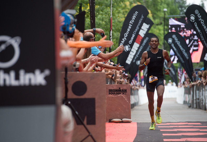 """Edwin Espinoza, of Caracas, approaches the finish line during the 2016 Ironman Boulder on Sunday. <br /> More photos:  <a href=""""http://www.dailycamera.com"""">http://www.dailycamera.com</a><br /> (Autumn Parry/Staff Photographer)<br /> August 7, 2016"""