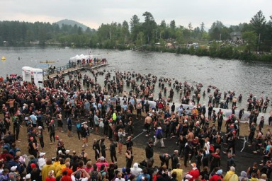 6:50am - athletes congregate on the beach of Mirror Lake prior to the 7am start.  Note the white arch on the left side - we all had to pass through this before we entered the water to allow the electronic timing chips we wore on our ankles to register.