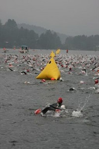 A sample of the chaos on the swim - the 10-foot high yellow triangular buoys marked the left side of the swim course and gave us something to sight for between strokes to stay on course.