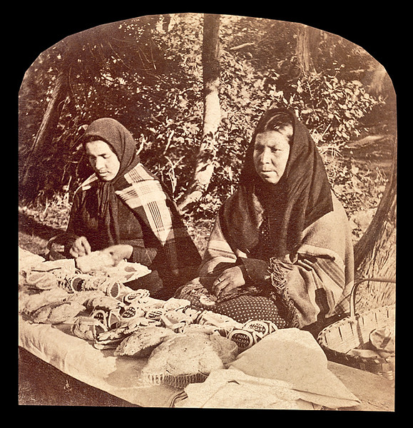 Selling Iroquois beadwork, ca. 1890.  (Same women as in picture 117.) Stereocard.