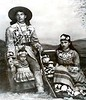 Photograph of an Iroquois family, ca. 1885, the man with a similar jacket and the woman with a collar similar to the one shown in picture 11.
