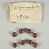 Peach pit game tokens with known provenance.  Late 19th/early 20th century.