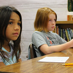 Students in Mrs. Browns 4th grade class listening to a poem being read out loud.