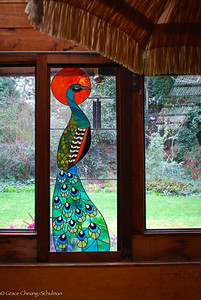 Beautiful peacock stained glass decorates the restaurant Mummy's Kitchen.