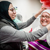 At left, Miriam Bounar of Boxboro teaches Elizabeth Buckley of Andover how to put on a hijab at the open house for Islamic Society of Greater Lowell in Chelmsford. SUN/Caley McGuane