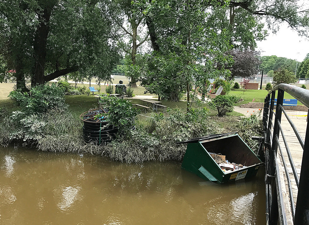 . Lisa Yanick Litwiller - Morning Sun  Island Park in Mt. Pleasant remains closed Wednesday, June 28, 2017 indefinitely as crews work to clean up sediment, possible contamination and more left in the wake of a massive flood over the weekend.