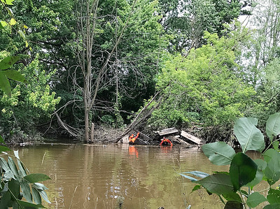 Lisa Yanick Litwiller - Morning Sun  Island Park in Mt. Pleasant remains closed Wednesday, June 28, 2017 indefinitely as crews work to clean up sediment, possible contamination and more left in the wake of a massive flood over the weekend.