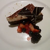 Flourless chocolate cake with double cream and steeped berries