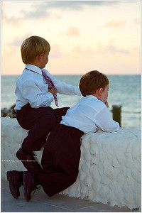"""Brothers"" Two brothers, a broad horizon stretching out before them, contemplate Life's limitless potential; or simply commiserate on why this wedding stuff takes so long."
