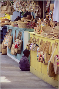 """Waiting at the Market"" While his mother sells her wares, a small boy waits patiently."