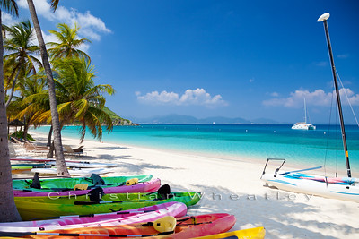 kayaks and paddleboards at a beach on Peter Island, BVI