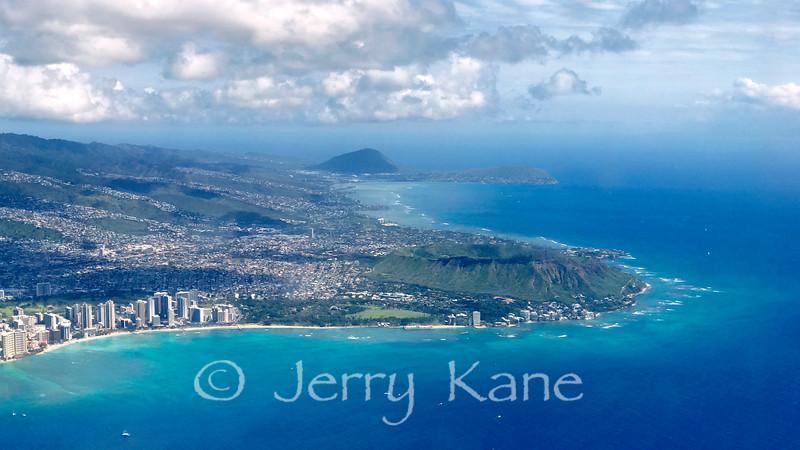 Honolulu, Oahu, Hawaii.  From the left - Waikiki Beach, Kapiolani Park, Diamond Head, and on the horizon - Koko Crater and Koko Head.