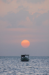 A fishing boat sits settled under a setting sun off the west coast of Trinidad (Waterloo).