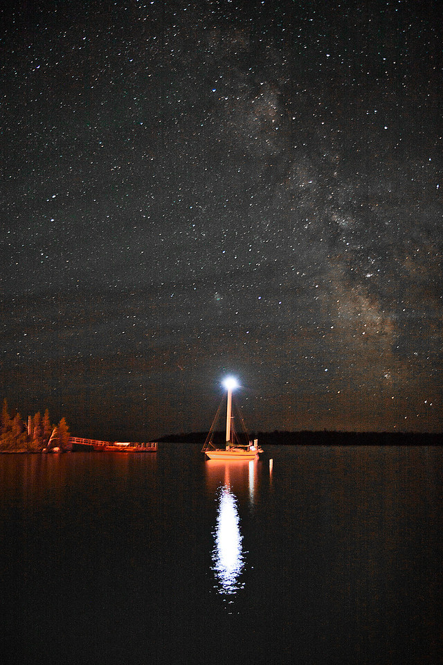 Anchored Sailboat under the Milky Way