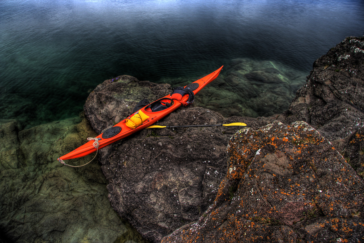 Kayak perched on the rocky shoreline of Amygdaloid Island, Isle Royale