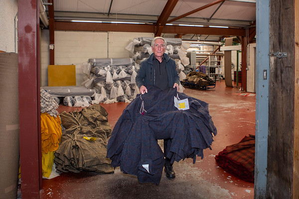 Donald, the Finishing Manager taking the tweed into Mill