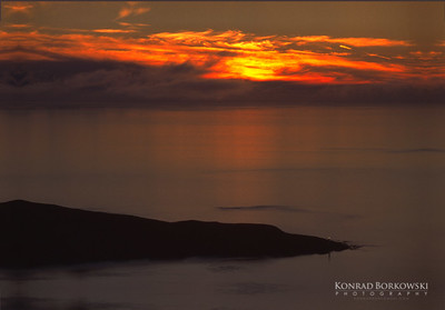 Sunset over Rhuvaal Lighthouse, view from the Paps of Jura, Isle of Islay
