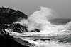 Man standing on a cliff during a storm at Saligo Bay, Isle of Islay