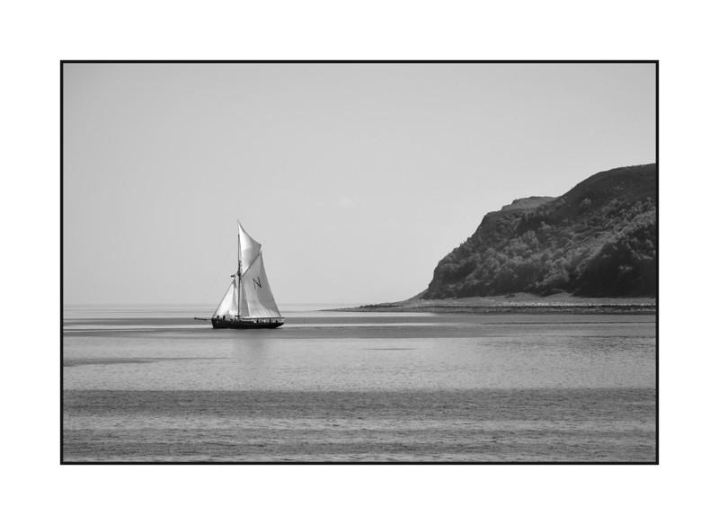 Gaff rigged yacht leaving Lamlash Bay.