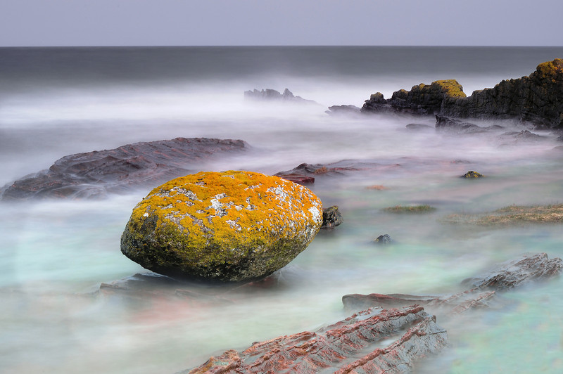 Boulder on the Merkland shore.<br /> This is from a set of images taken on a stormy day in April 2010, a long exposure has left the breaking waves as a mist.
