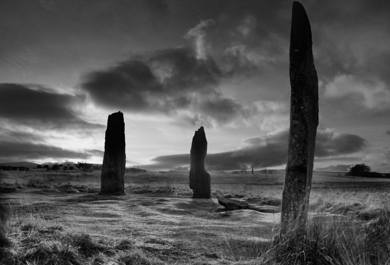 Machrie Moor standing stones. Looking West with the sun low over Kintyre.