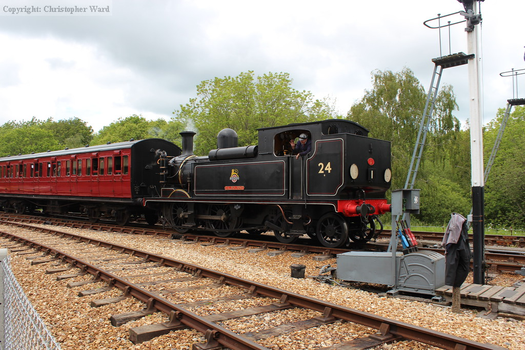 W24 rolls in with a train from Wootton