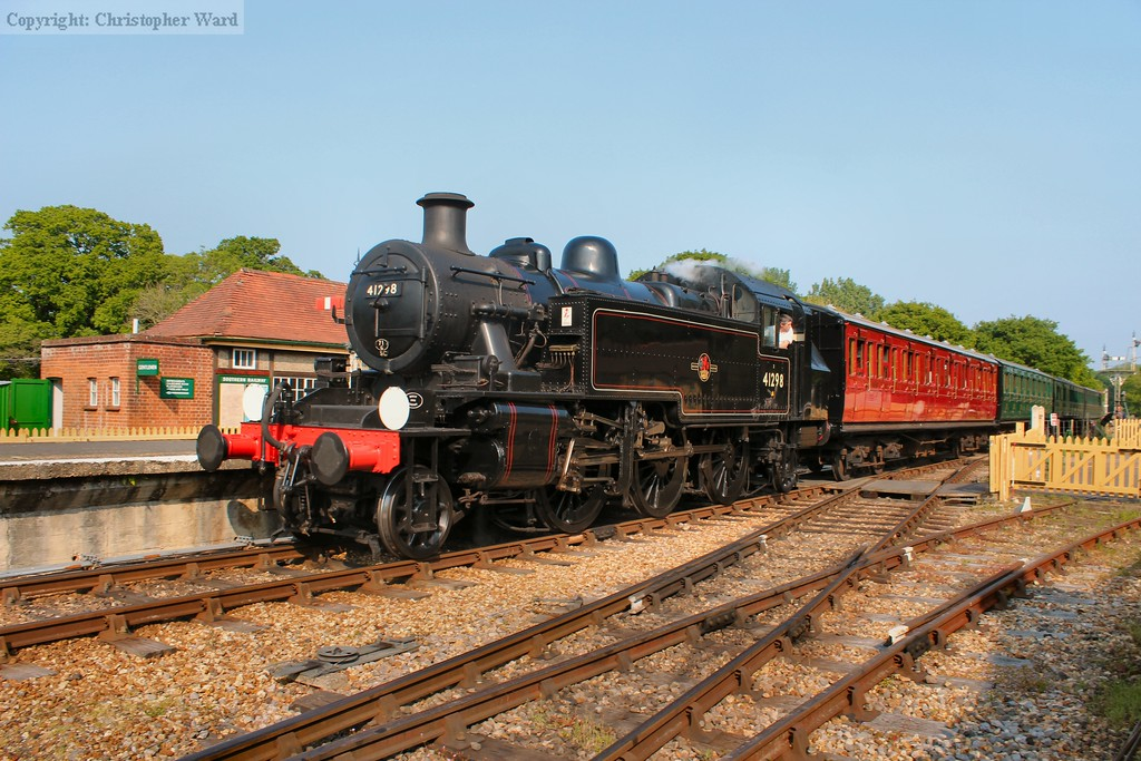 The Ivatt pulls into the station with a down train