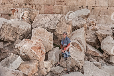 Tourist Posing on the Fallen Stones of the Second Temple in Jerusalem
