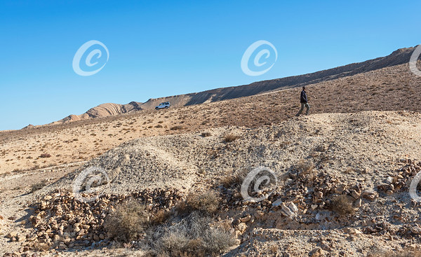 A Scientist Walks on Possible Prehistoric Ruins in the Makhtesh Ramon Crater