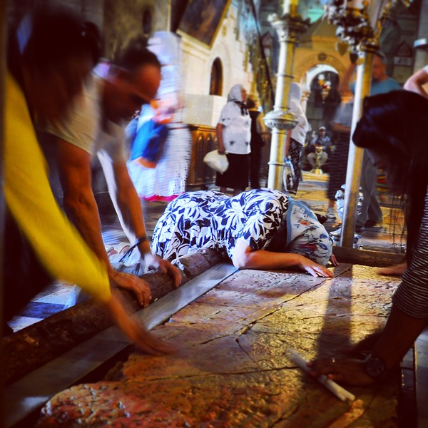 A woman prays on Jesus' tomb in the Church of the Holy Sepulchre. 2016.