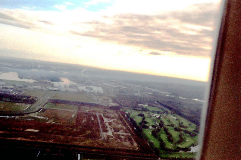 Fields and canals surround the airport and the city of Amsterdam.