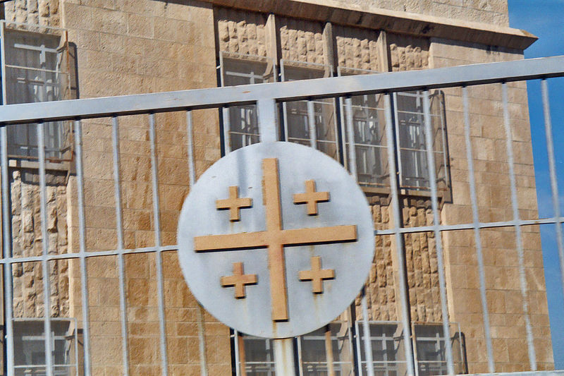 Jerusalem cross on a fence in Bethlehem.
