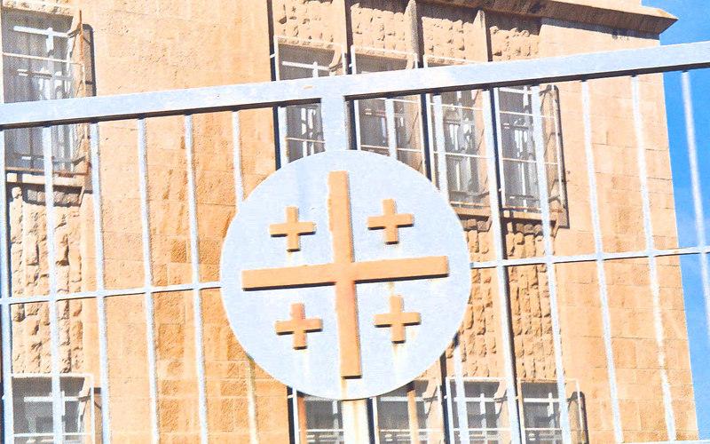 Check Photo: Jerusalem cross on a fence in Bethlehem