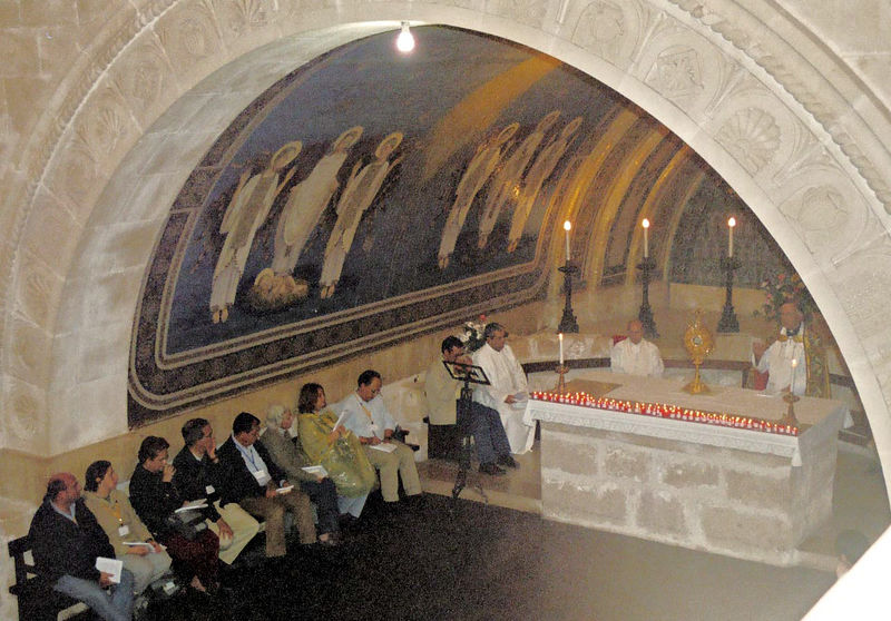 Russians say Taize prayer in front of the Monstrance during Benediction of the Blessed Sacrament at the site of the Transfiguration
