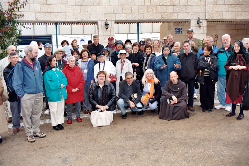 Roy Schoeman, Hebrew Catholic, writer, and apologist, on the left in a blue jacket. Carmen, who I sang with at the outdoor Mass at the Mount of Beatitudes and on the shore of the Sea of Galilee, Mary. I'm down in front in the black leather jacket. Father Larry Darnell is in the back row behind me. Renee is in the second row, third from the left.