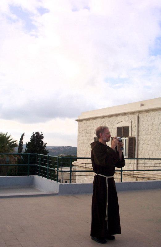 Father Joseph Mary takes a photo. Masada?  Photo by Nancy Chlebnik.