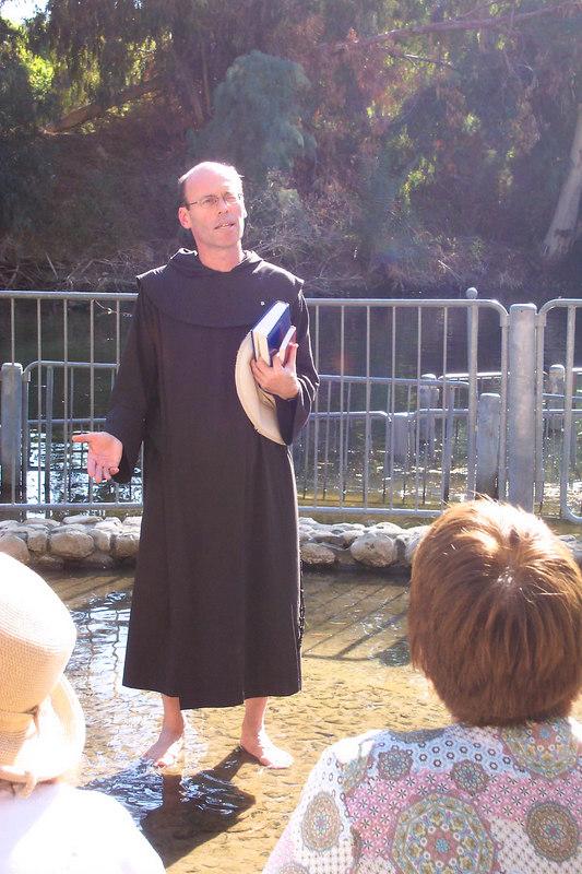 Fr. Tom Koller, barefoot in the Jordan.  Photo by Nancy Chlebnik.