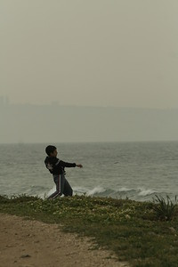 Throwing rocks to the sea, Haifa in the background