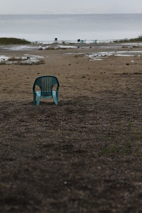 Chair on dry Kinneret Beach