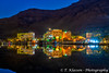 Hotels reflected in the Dead Sea at night in Ein Bokek, Israel, Middle East.