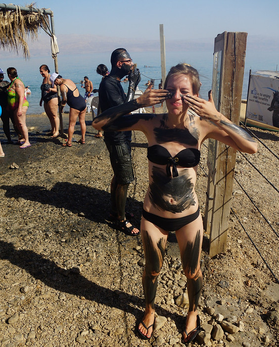 Covering myself in mud in the Dead Sea.