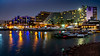 Reflections of hotels at the marina at night in Eilat, Israel, Middle East.
