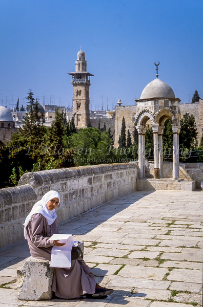 A young Muslim girl studying on the Temple Mount in Jerusalem, Israel.