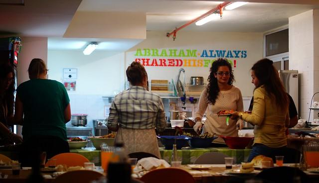 Preparing Shabbat dinner at Abraham Hostel Jerusalem