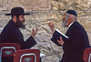 Two Orthodox Jews in discussion at the Western Wall in Jerusalem, Israel.