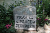 Pray for Peace in Jerusalem carved into rock in Garden Tomb gardens