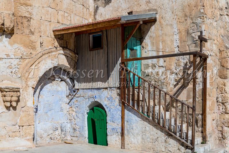 A rustic church side door in Jerusalem, Israel, Middle East.
